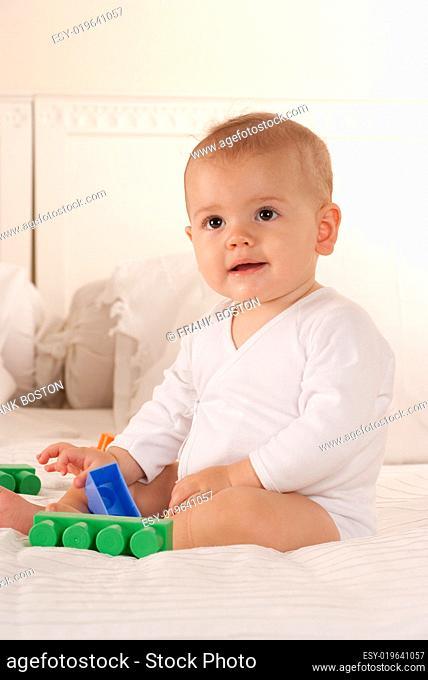 Baby and playing bricks