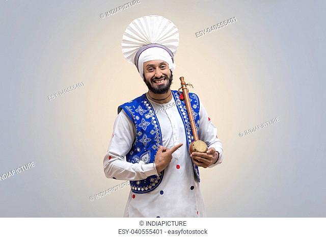 Standing Of Sikh man with Tumbi