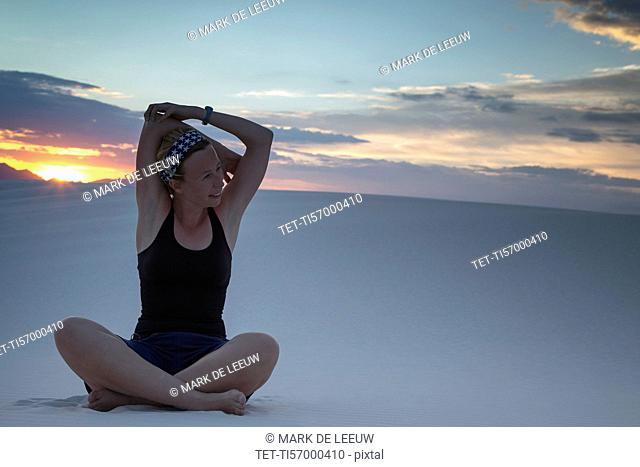 Mid-adult woman doing yoga in desert