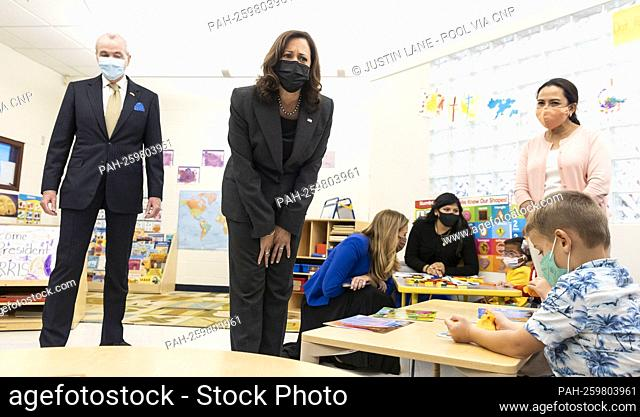 United States Vice President Kamala Harris (C) and Governor Phil Murphy (Democrat of New Jersey) (L) talk with children in a classroom during a visit to the Ben...