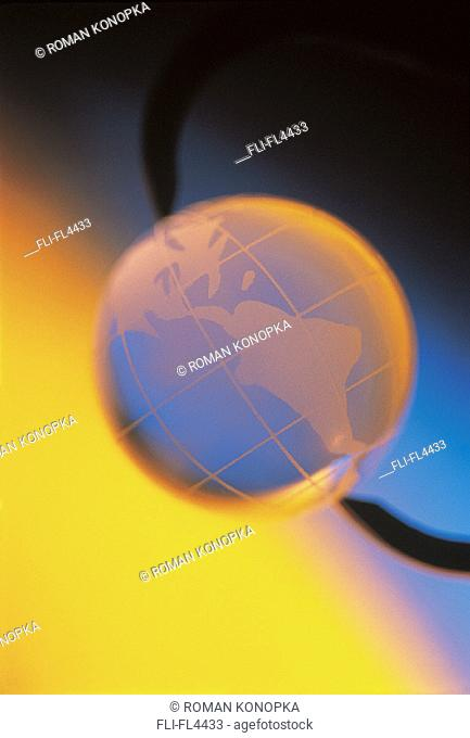 Globe Held in Clamp with Glowing Yellow/Blue Background