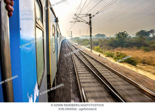 View from a train passing through rural areas in Ludhiana, India