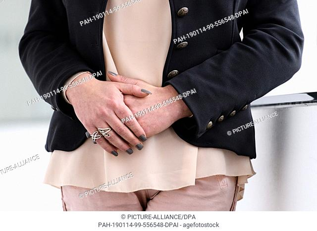 14 January 2019, Bavaria, München: Rings are on the fingers of Tessa Ganserer (Bündnis 90/Die Grünen), who is standing on a corridor of the Landtag building...