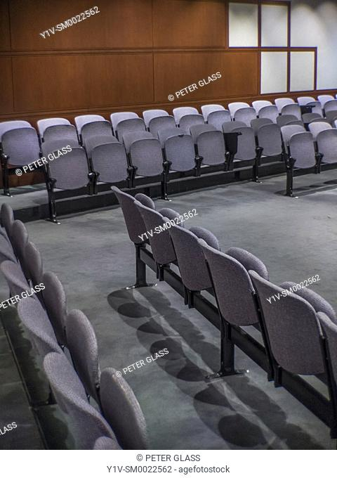 Empty auditorium with its chairs folded up
