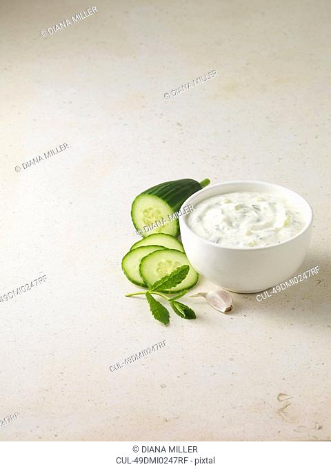 Bowl of tzatziki with cucumber