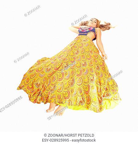 Pretty woman lying in a dress on floor