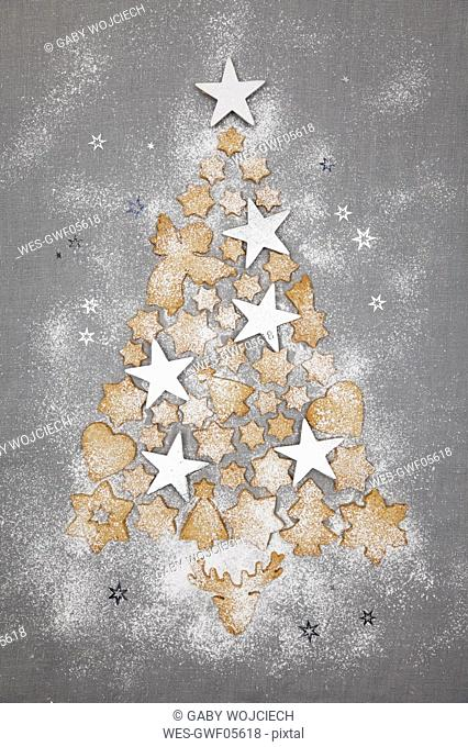 Christmas Cookies And White Stars Forming Christmas Ttee On Grey Background