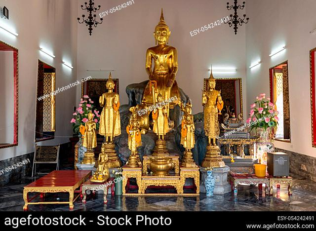Golden Buddhas in four pavilions called Vihara, situated in the Wat Pho temple in Bangkok