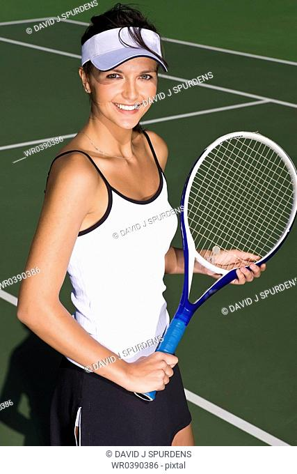 A happy tennis player on court