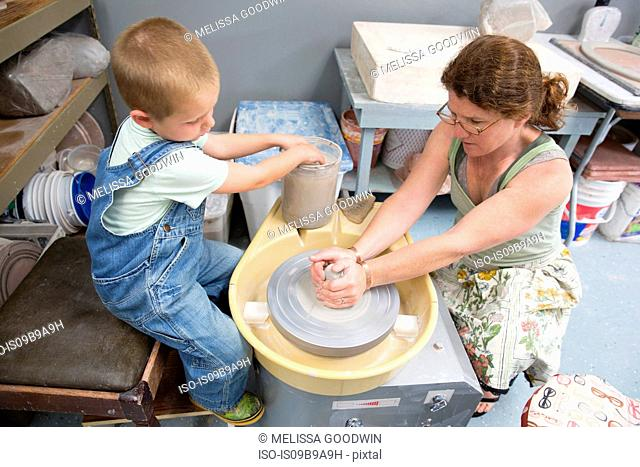 Mother and son working with clay