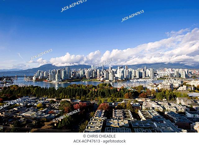 Burrard and Cambie Bridges, city skyline with new retractable roof on BC Place Stadium, False Creek, Vancouver, British Columbia, Canada