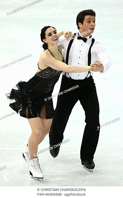 Tessa Virtue and Scott Moir of Canada perform during the Figure Skating Ice Dance Short Dance event at the Iceberg Palace during the Sochi 2014 Olympic Games in...