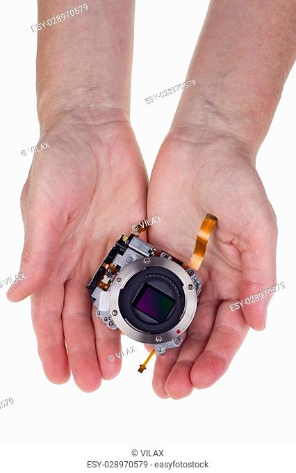 Modern hi-tech image sensor for a mass production camera in worker hands for you. Isolated on white