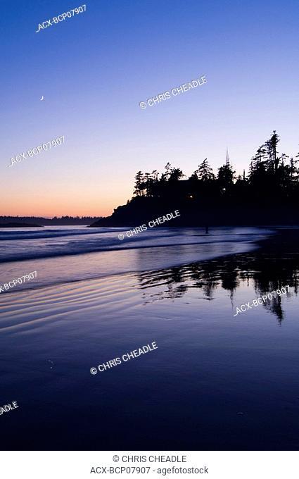 twilight reflects on wet sand, MacKenzie Beach at Tofino, Vancouver Island, British Columbia, Canada