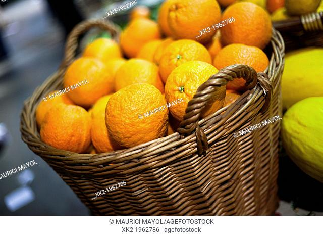 Oranges in a wicker basket in Borough Market, London, UK