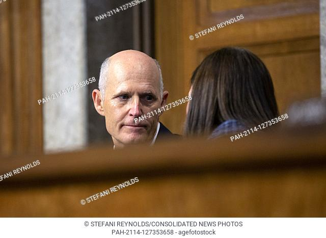 United States Senator Rick Scott (Republican of Florida) speaks to United States Senator Martha McSally (Republican of Arizona) as Director of Defense...