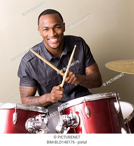African American man playing drums