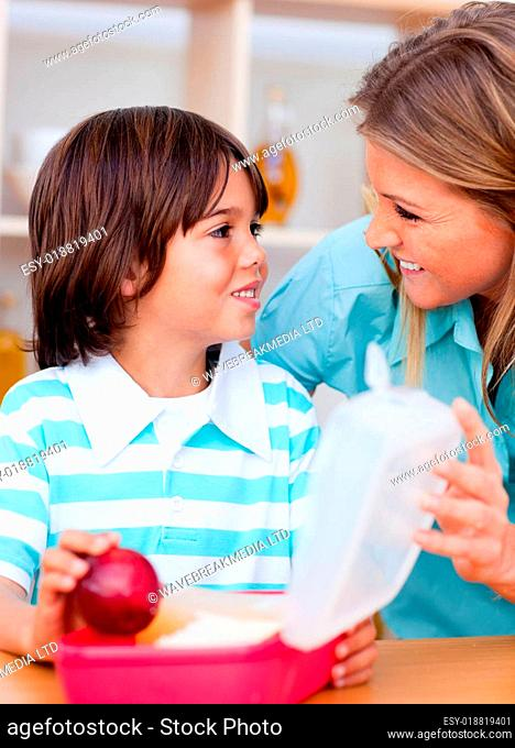 Joyful little boy and his mother preparing his s ck