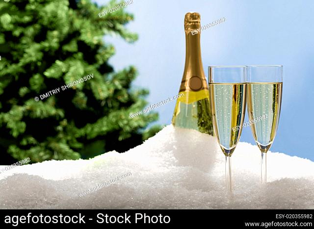 Champagne flutes in snow