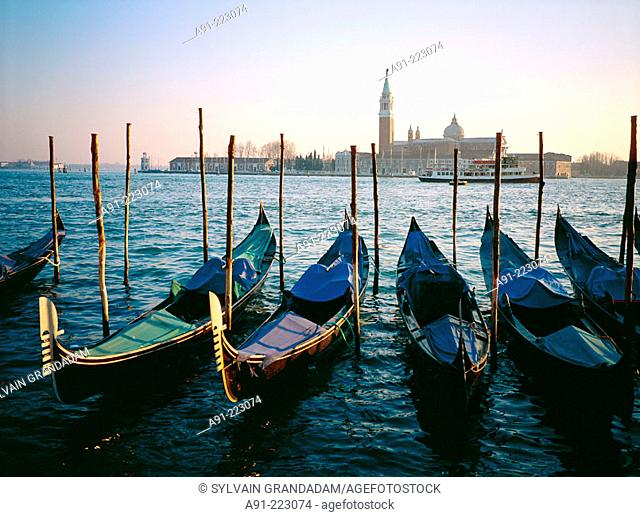 Gondolas pier and San Giorgio Maggiore church in background. Venice. Italy