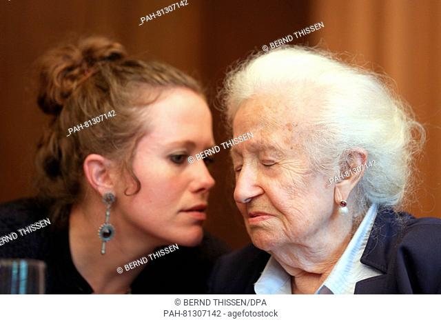 Auschwitz survivor Erna de Vries(r) and her granddaughter participating in a press conference after the verdict at the regional court in Detmold, Germany