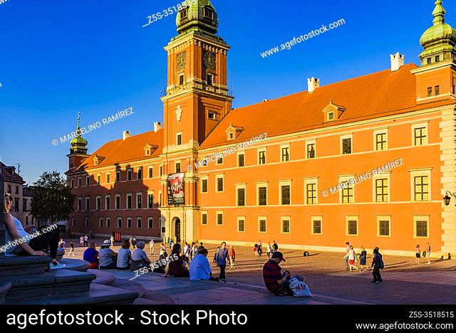 Tourists and locals relaxing on the Sigismund's Column stairs at sunset, Old Town. Warsaw, Poland, Europe