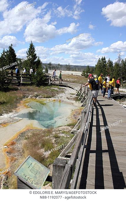 Visitors at West Thumb geothermal area, Yellowstone National Park, Wyoming, USA