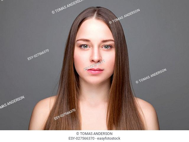 Beautiful young brunette with long straight hair