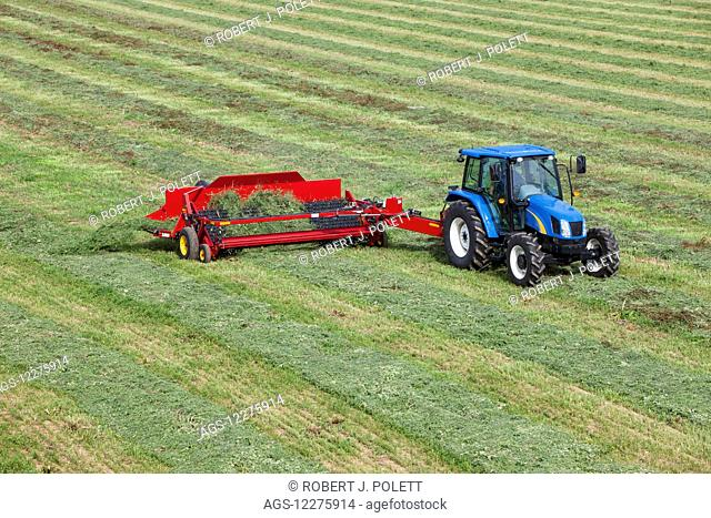 New Holland t5040 with H5430 windrow merger; New Holland, Pennsylvania, United States of America