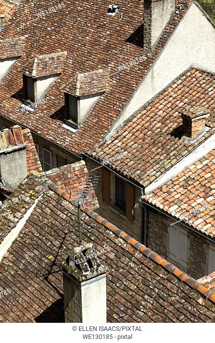 Red tile and stone roofs and chimneys in Rocamadour, France