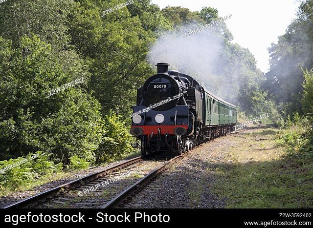 Class 4MT Standard Tank 80078 heads a train on the Spa Valley Railway , Kent