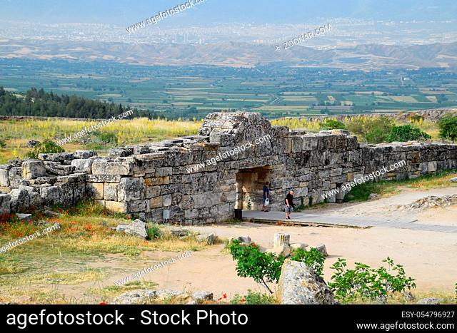 Pamukkale, Hierapolis, Turkey - May 22, 2019: Tour groups on the ruins of Hierapolis. Tourists are shown the ruins of the ancient city
