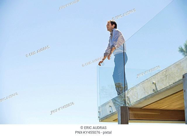 Man standing on the terrace looking away