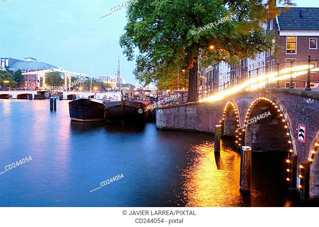 Bridge on Keizersgracht with Skinny Bridge on Amstel canal in background. Amsterdam. Netherlands