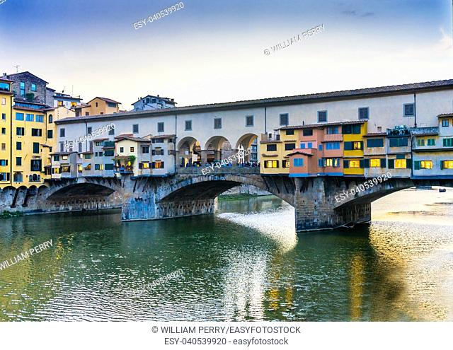 Evening Sunset Arno River Ponte Vecchio Florence Tuscany Italy. Bridge originally built in Roman times, rebuilt in 1345