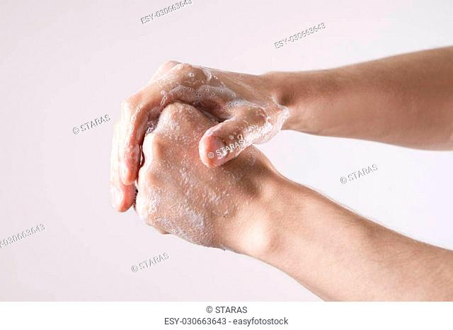 Lathered men's hands. Personal hygiene, cleansing the hands
