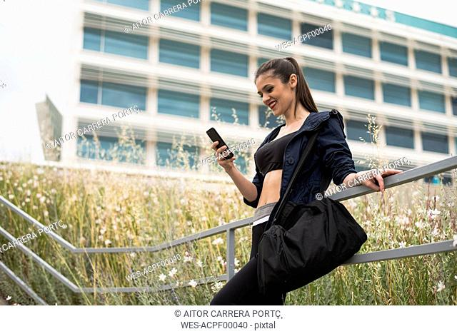 Sportive woman reading message