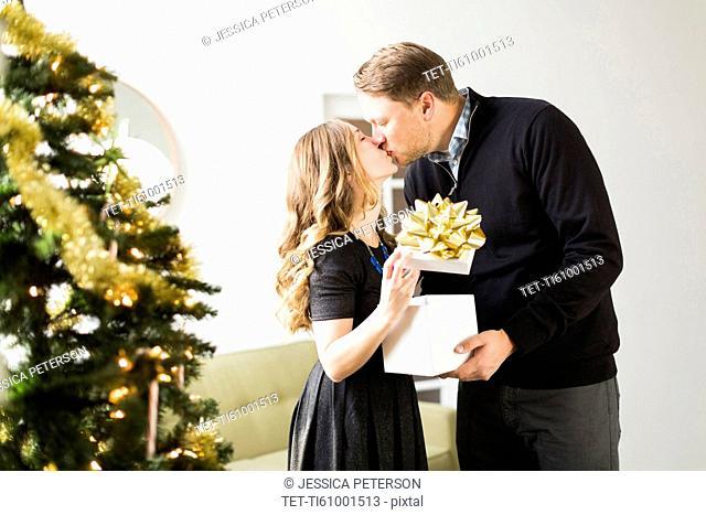 Woman and man kissing at Christmas