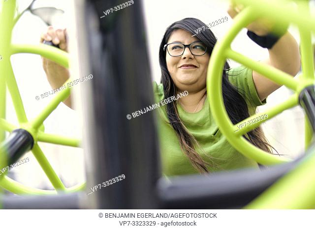 obese woman training with gym machine