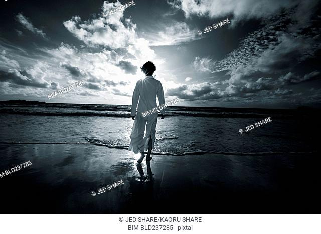 Japanese woman walking on beach