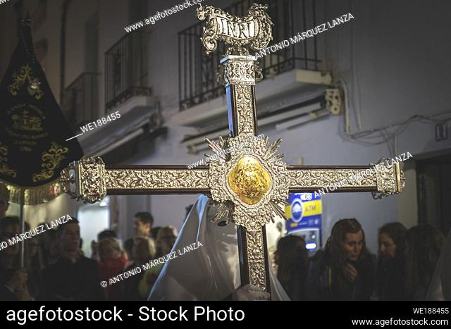 Cross guide in a procession at the holy week in Marbella with nazarene