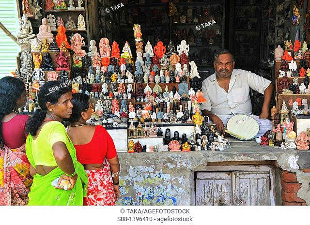 Gods statue shop at the shopping street from the ghat