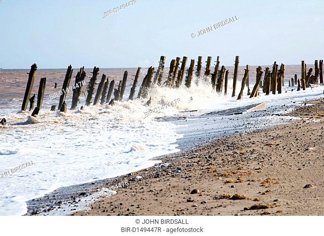 Waves crashing onto a groyne at Spurn Head, East Yorkshire, which is being eroded by the sea