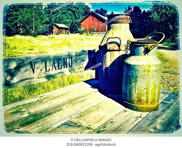 Milk churns outside farm, Ljustero, Sweden, Scandinavia