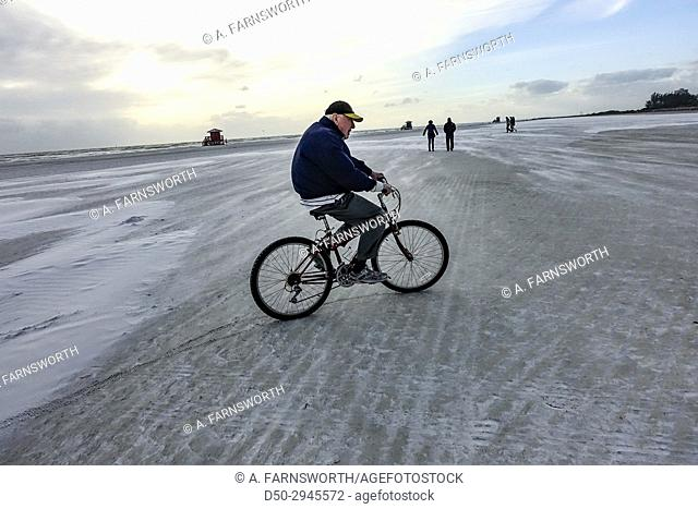 SARASOTA FLORIDA Retired man bicycles on beach
