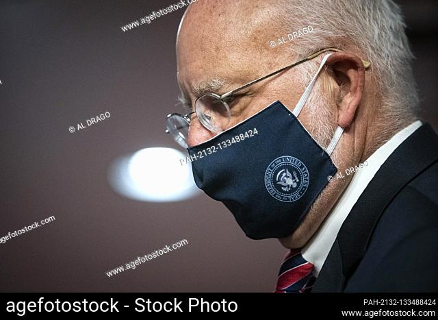 Robert Redfield, director of the Centers for Disease Control and Prevention (CDC), wears a face covering during a Senate Health, Education