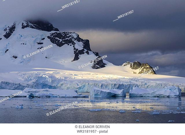 Early morning atmospheric cloud, mountains, glaciers and icebergs, Ronge Island, Errera Channel, Antarctic Peninsula, Antarctica, Polar Regions