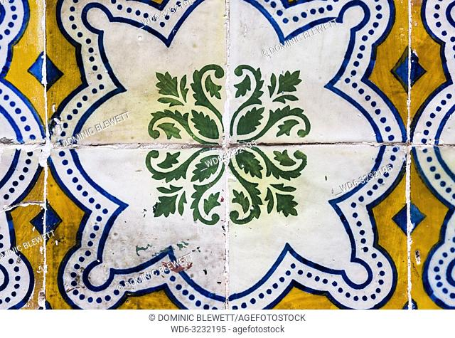 Traditional tiles on a building facade in Lisbon, Portugal