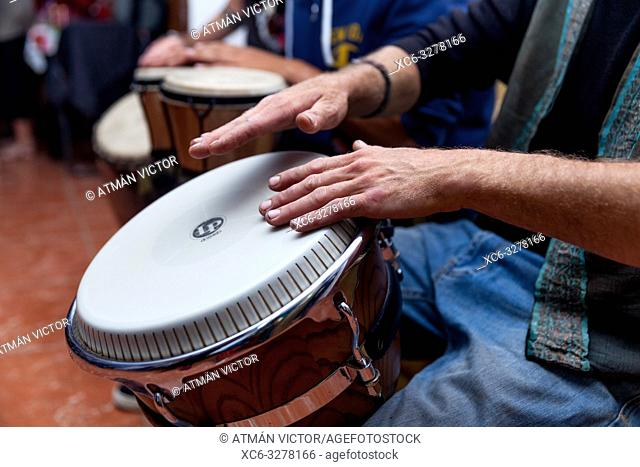 musicians playing Bongo drums