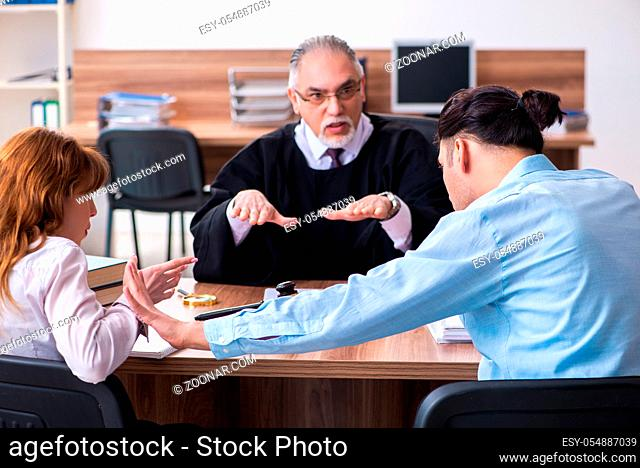 Young couple in the courthouse in divorce concept